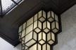 Detalhe de um dos adornos luminosos situados na fachada principal, ornamentando a porta principal<br />Foto Georges de Kinder  [Ma² - Metzger and Partners Architecture]