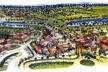"""Folheto turístico da Costa do Sauípe (BA). O complexo hoteleiro inclui, entre outros atrativos, esta recriação de cidade colonial, denominada """"Vila Nova da Praia"""", uma montagem cênica de referências arquitetônicas estilizadas. Um não-lugar? [Costa do Sauípe Resort. 2001]"""