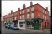 Penny Lane é a rua comercial mais importante do subúrbio onde moravam os integrantes dos Beatles<br />Foto Victor Hugo Mori