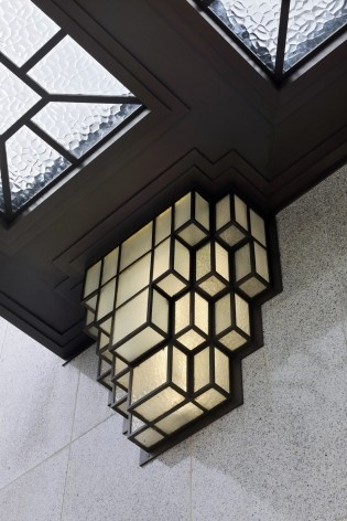 Detail of the adornments of a light located on the main facade, decorating the front door<br />Foto Georges de Kinder  [Ma² - Metzger and Partners Architecture]