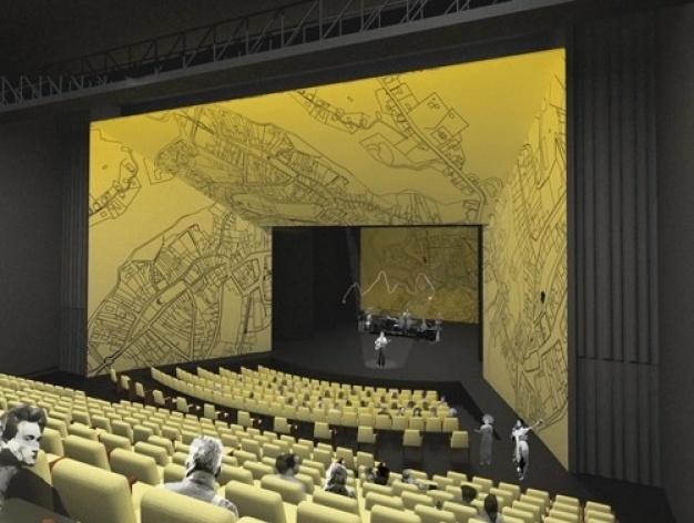 Vista do teatro de fala com a cenografia nos planos refletores laterais<br />Imagem do autor do projeto