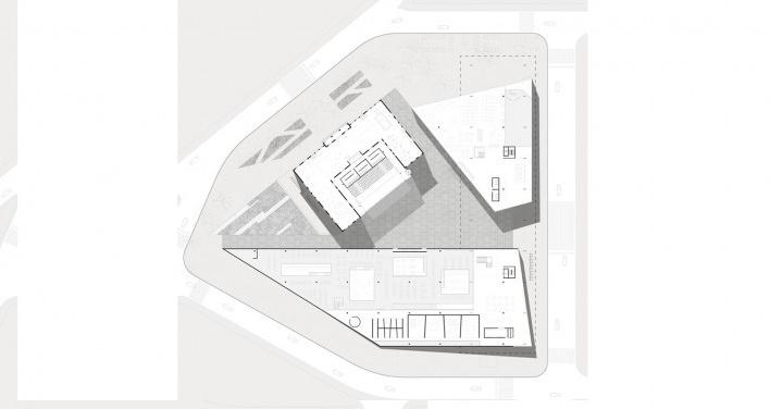 Planta na cota mais baixa do terreno: estúdios, oficinas, biblioteca, sala de exposições, foyer e abertura do auditório para o Largo no interior da quadra