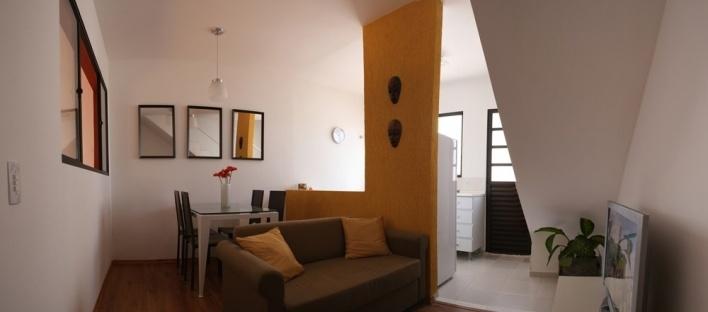 Vista interior da unidade - sala e cozinha