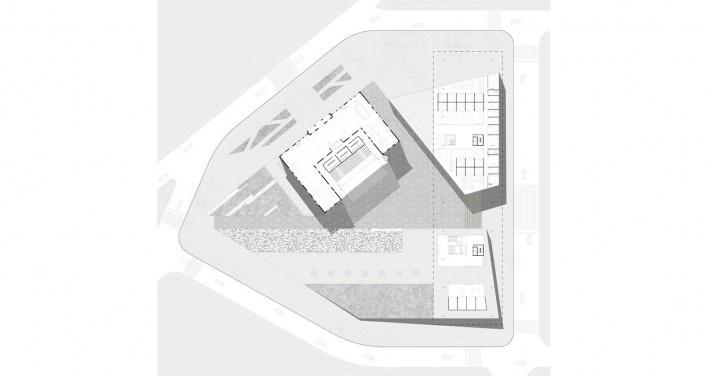 Planta na cota mais elevada do terreno: eixo de entrada por sobre o volume dos estudios; departamentos e café